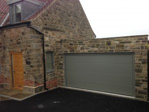 Hormann L-Ribbed Sectional in Stone Grey By ABi Garage Doors