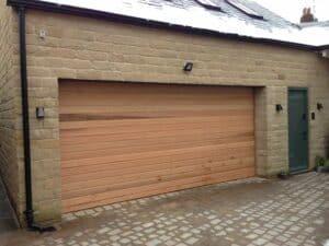 Horizontal Up and Over Cedar Timber Door By ABi Garage Doors