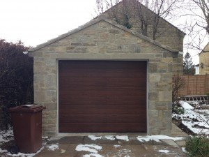 Hormann M-Ribbed Sectional in Decograin Rosewood By ABi Garage Doors