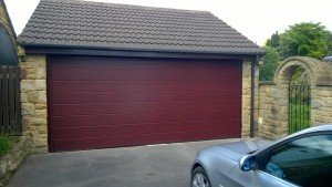 Hormann M Ribbed Sectional Garage Door in Rosewood By ABi