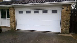 Hormann L Rib Sectional Garage Door with Glazing By ABi