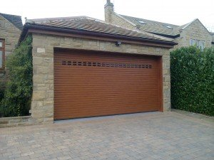 Hormann RollMatic Insulated in Golden Oak with Glazing By ABi