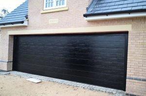 Hormann Sectional Garage Door in Black Woodgrain By ABi