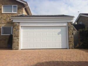 Hormann S-Panel Insulated Sectional Garage Door in Woodgrain by ABi Garage Doors