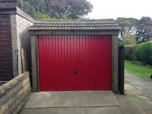 Select Steel Vertical Up and Over in Red By ABi Garage Doors