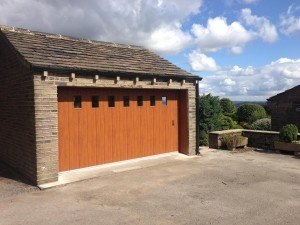 Hormann M Rib Side Sliding Garage Door in Golden Oak with Glazing By ABi Garage Doors