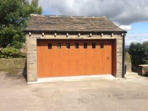 Hormann M Rib Side Sliding Garage Door in Golden Oak with Glazing ABi Garage Doors