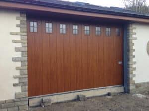 Hormann Vertical Side Sliding Garage Door in Decograin with Glazing By ABi Garage Doors