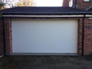 SWS Vertico Side Sliding Garage Door in White By ABi Garage Doors