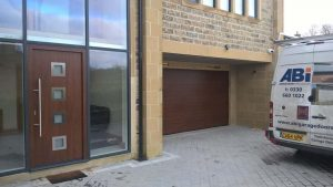 Hormann Front Entrance Door with Matching Sectional Garage Door By ABi