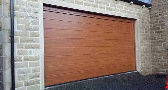 Peter Holmes Developments commission ABi Garage Doors to install a Hormann LPU40 medium ribbed design 42mm Insulated sectional garage door in Halifax