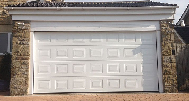 Fully automatic Hörmann made to measure LPU40 insulated Georgian design sectional door, including a low headroom kit, installed in Pannal, Harrogate.
