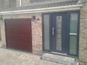 Sectional Garage Door Installed by ABi. Also in shot is a Hörmann Steel Entrance Door.