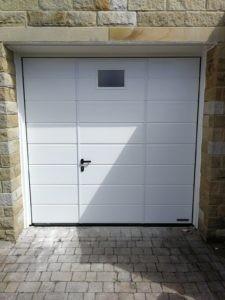 Hörmann Sectional Garage Door with a Wicket Door and Window