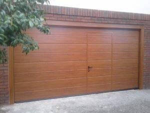 Hörmann Sectional Garage Door in Brown with a Wicket Door