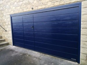Hörmann Sectional Garage Door With a Wicket Door in Blue