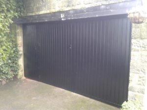 Side-Hinged Garage Door With A Garage Side Door In Black