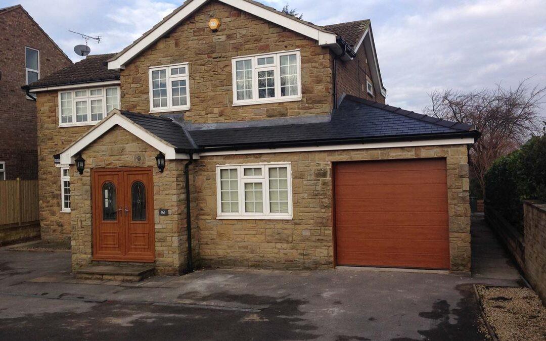 Hormann made to measure LPU40 Decograin timber effect sectional garage door installed in Leeds
